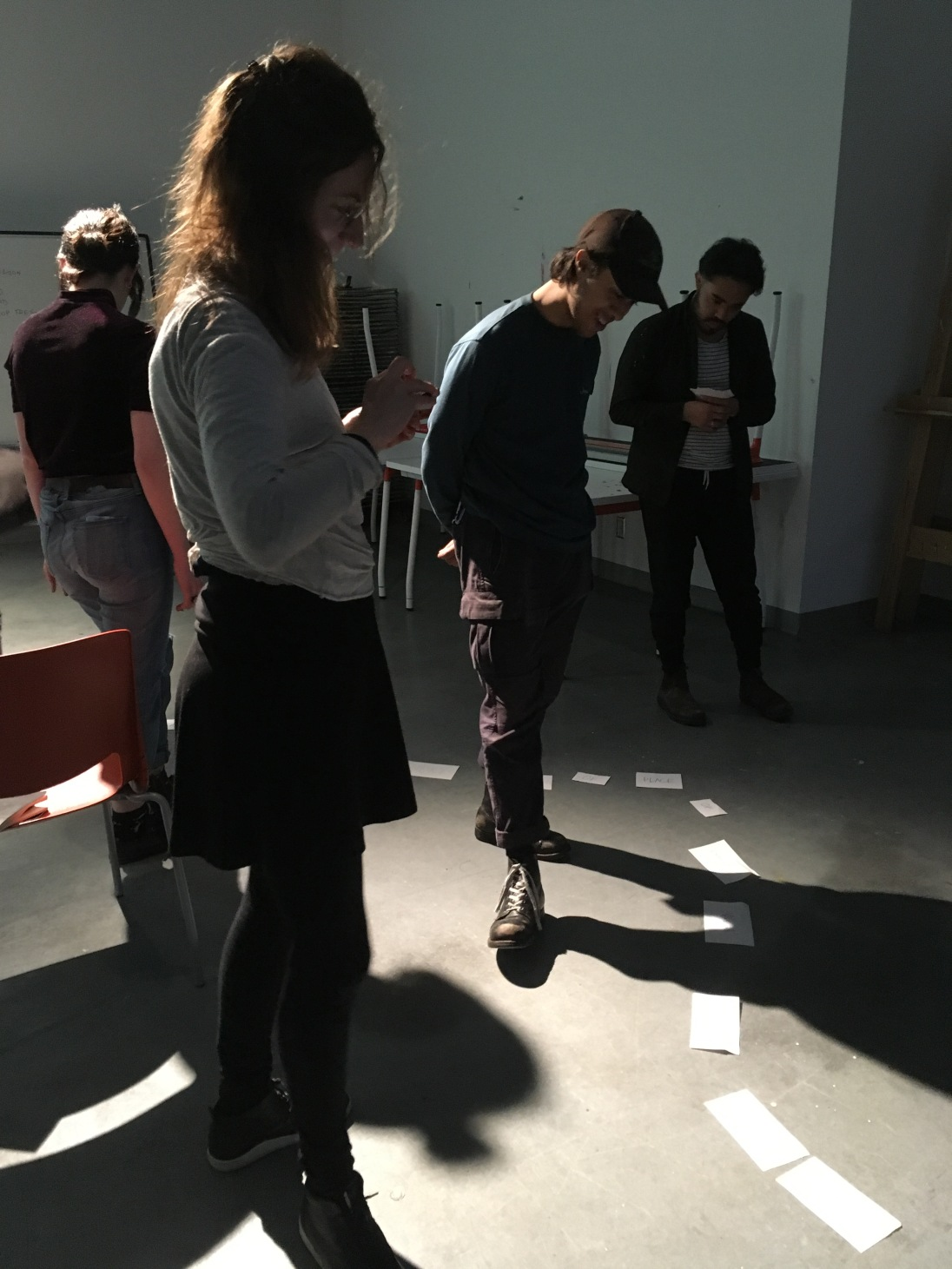 Amy and students looking at the words that will become poetry (ECUAD, Great Northern Way)